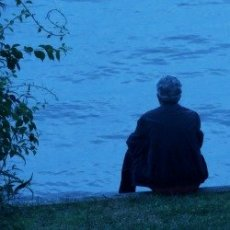 man sitting alone thinking,millionaire commits suicide