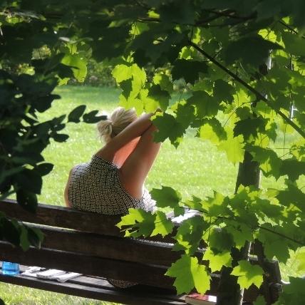 millionaire mindset woman,sitting on bench