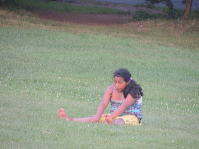 teen sitting on grass alone,no teenage suicide